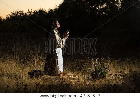 Classical Girl Praying On The Countryside