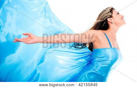 Woman in a blue dress feeling the wind - isolated over a white background