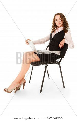 Beautiful Woman With Laptop Sitting On The Chair