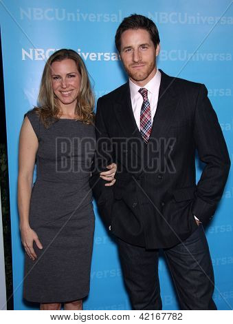 LOS ANGELES - JAN 06:  SAM JAEGER & WIFE arriving to TCA Winter Press Tour 2012: NBC Party  on January 06, 2012 in Pasadena, CA