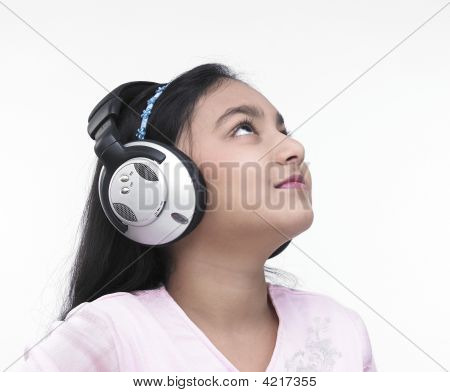 Teenage Girl Of Indian Origin Listening To Music