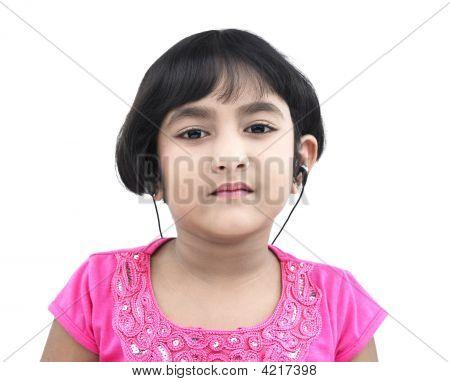 Asian Girl Of Indian Origin With Earphone