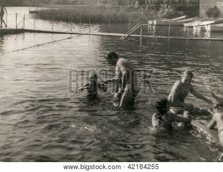 Vintage photo of family playing in water(early eighties)