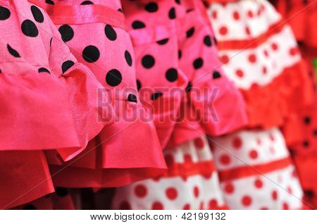 closeup of a pile of flamenco dresses, typical of Spain