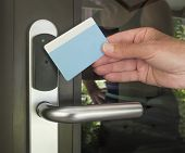 pic of keyholes  - Plastic hand touch keycard on hotel door