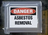 stock photo of asbestos  - Danger Asbestos Removal Sign posted on school window - JPG