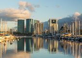 image of waikiki  - Yachts line harbor at Ala Moana near Waikiki Oahu Hawaii with reflections of office and hotel buildings in still water - JPG