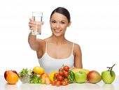 stock photo of vegan  - beautiful woman with healthy food and water - JPG