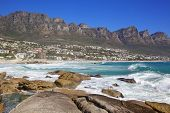 stock photo of 12 apostles  - Camps Bay Beach in Cape Town, South Africa, with the Twelve Apostles in the background.