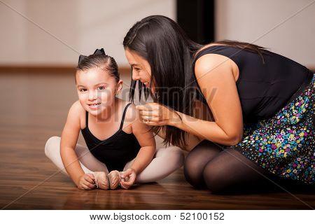Little girl and her dance teacher