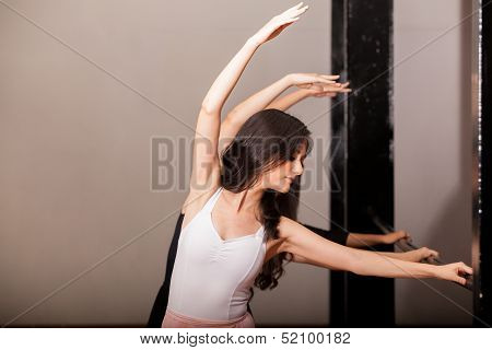 Practicing in a ballet barre