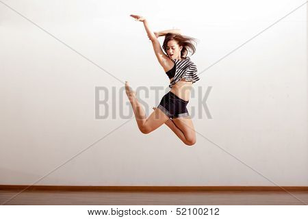 Sexy jazz dancer in the air