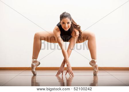 Pretty ballet dancer rehearsing