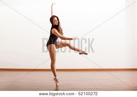 Beautiful ballerina in a studio
