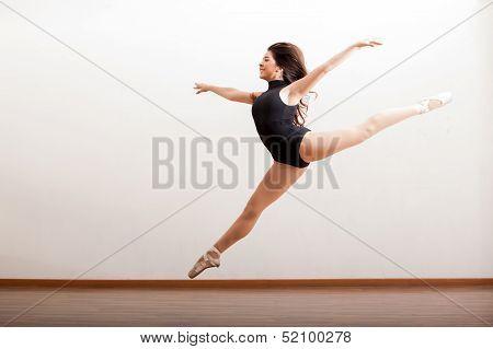 Happy ballet dancer jumping