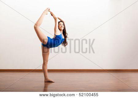 Happy ballet dancer rehearsing