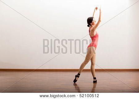 Cute ballerina performing