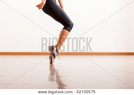 Tap dancing in a dance studio