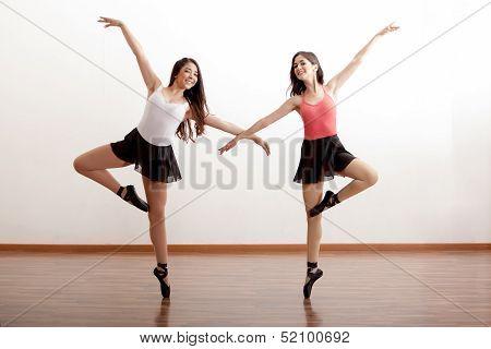 Happy ballet dancers in a studio