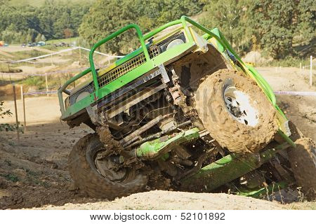 Green Off-road Car In A Difficult Terrain