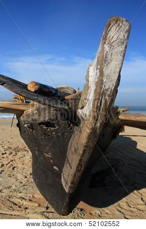 Fishing boat on Goa beach, India.