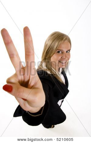 Wide Angle Picture Of An Attractive Businesswoman Making Her Victory Sign