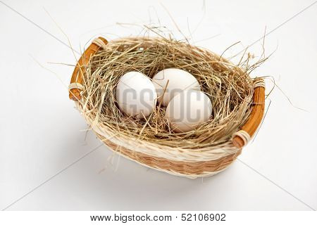Basket with white chicken eggs