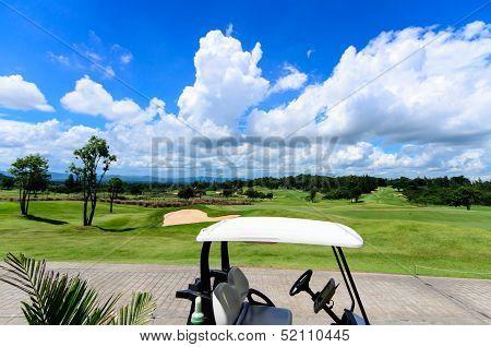 Part Of Golf Cart Facing To Blue Sky