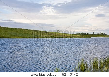 River Landscape With Green Fields