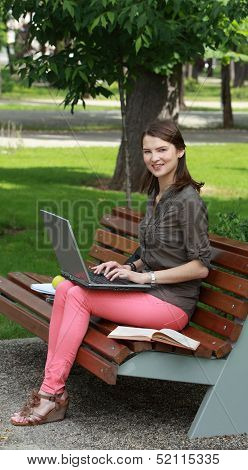 Young Woman With A Laptop In A Park