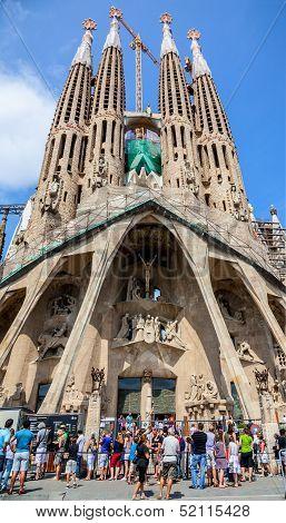 Tourists In Front Of Sagrada Familia In Barcelona