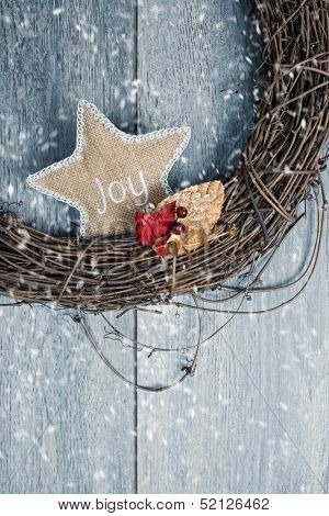Close up of rustic Christmas wreath in winter snow