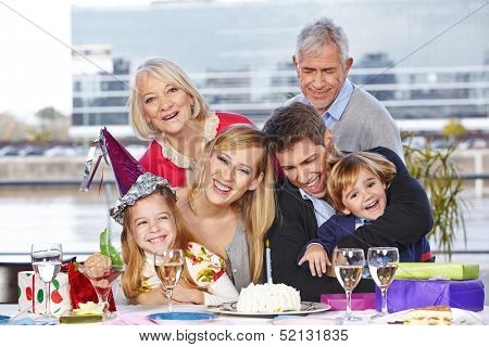 Happy family having fun at birthday party of their daughter