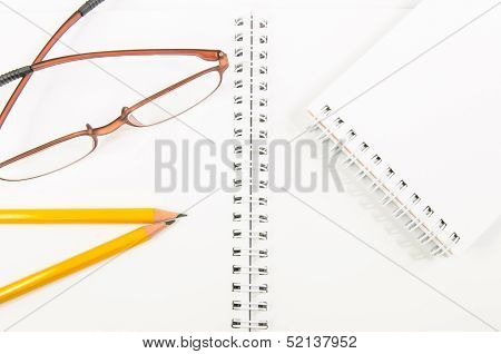 Notebook And Yellow Pencil And Eyeglass