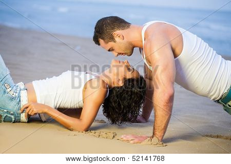 Young couple lying down on beach