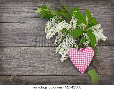 White Bird-cherry Tree Flowers On A Wooden Background