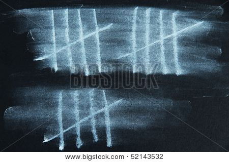 Counting days by drawing sticks isolated on black