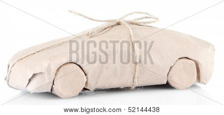Car wrapped in brown kraft paper, isolated on white