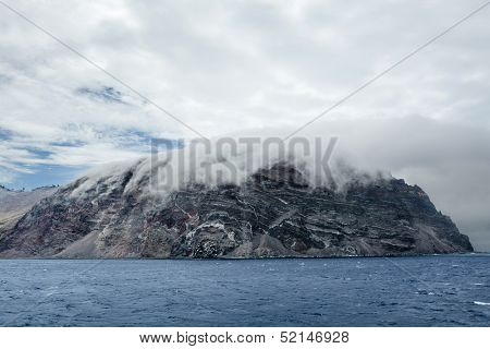 Low clouds hug the remote island of Guadalupe in Mexico.