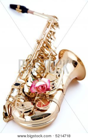 Gold Saxophone With Pink Rose On White