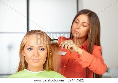 Hair Salon. Womens Haircut. Use Of Straightener.