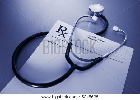 Rx Prescription Form And Stethoscope On Stainless Steel Desk