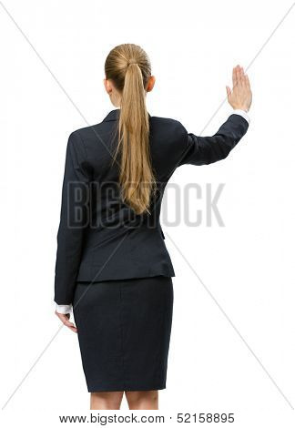 Backview of businesswoman waving her hand, isolated on white. Concept of leadership and success