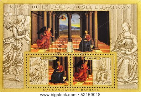 A stamp printed in France shows the famous painting The Annunciation Raphael