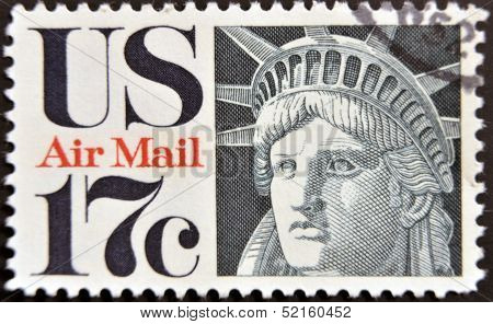 A stamp printed in the USA showing the face of the Statue of Liberty