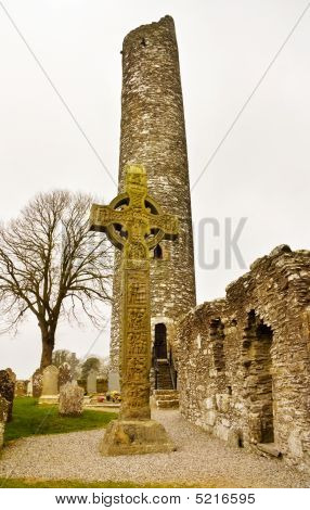 Monasterboice - View Over The North Celtic Cross And The Round Tower