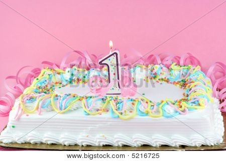 Pretty Birthday Cake Decorated And With One Lit Candle.