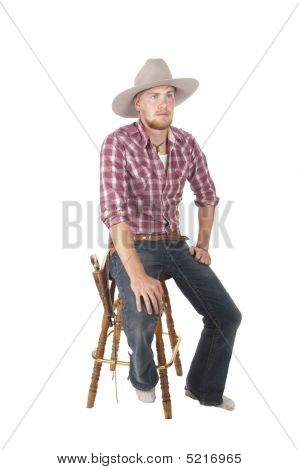 Bootless Cowboy Sitting On Stool