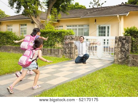 Happy Father With Kids In Front Of House