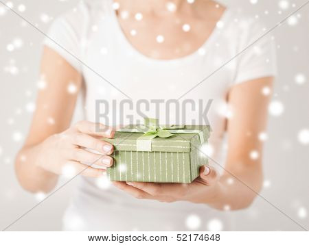 christmas, x-mas, gifts, presents, celebration concept - woman hands holding gift box